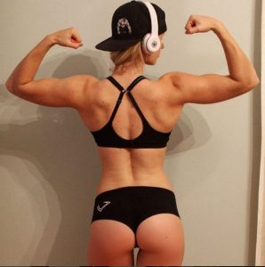 gripped fitness audio blonde woman with gym headphones