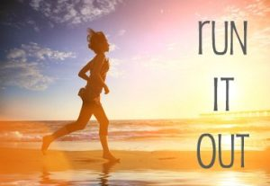 Woman running by the ocean beach at sunset jogging tips by gripped fitness audio