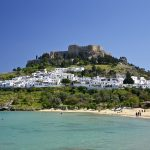 Should I rent a car in Rhodes or is there another way to explore the island?